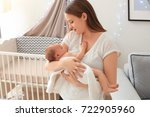 mother holding sleeping newborn ... | Shutterstock . vector #722905960