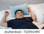 asian man sleeping comfortably... | Shutterstock . vector #722931490