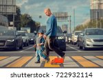 Little Boy With His Father And...