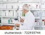male pharmacist counting stock... | Shutterstock . vector #722935744