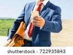 businessman holding smart phone ... | Shutterstock . vector #722935843