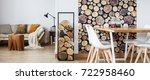firewood next to white chairs... | Shutterstock . vector #722958460