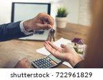 real estate broker agent giving ... | Shutterstock . vector #722961829