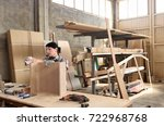 a woman working in a carpentry... | Shutterstock . vector #722968768