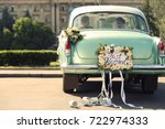 Wedding Couple In Car Decorate...