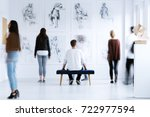 man sitting on stool and... | Shutterstock . vector #722977594