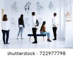 visitors in art gallery with... | Shutterstock . vector #722977798