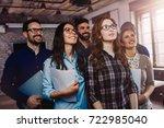 happy successful company staff... | Shutterstock . vector #722985040