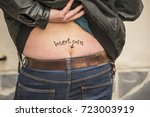 insert coin slot in man ass... | Shutterstock . vector #723003919