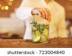 bartender making two mojito... | Shutterstock . vector #723004840