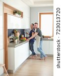 couple cooking together in... | Shutterstock . vector #723013720