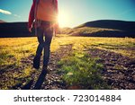 young woman hiker hiking in the ... | Shutterstock . vector #723014884