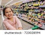 happy little customer girl... | Shutterstock . vector #723028594