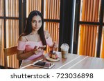 asian girl drink coffee  | Shutterstock . vector #723036898