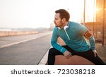 handsome man stretching before... | Shutterstock . vector #723038218