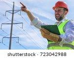 electrician working in a helmet ... | Shutterstock . vector #723042988