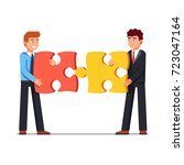 business men joining together... | Shutterstock .eps vector #723047164