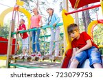 kids on playground | Shutterstock . vector #723079753