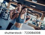 young couple is working out at... | Shutterstock . vector #723086008