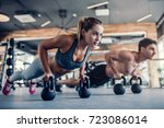 young couple is working out at... | Shutterstock . vector #723086014