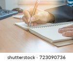 hand writing notebook in office | Shutterstock . vector #723090736