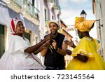 tourist dancing with local ... | Shutterstock . vector #723145564