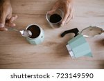 pouring coffee in a moka pot | Shutterstock . vector #723149590