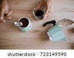 pouring coffee in a moka pot   Shutterstock . vector #723149590