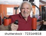 attractive senior man in gym... | Shutterstock . vector #723164818