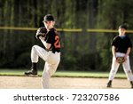 pitcher in youth baseball game | Shutterstock . vector #723207586
