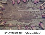 colorful flower petals on old... | Shutterstock . vector #723223030