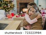 sad little girl is cuddling...   Shutterstock . vector #723223984
