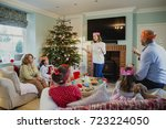 family are playing charades at... | Shutterstock . vector #723224050