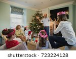 family are playing charades at... | Shutterstock . vector #723224128