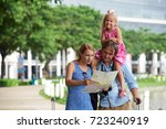 family using map to find... | Shutterstock . vector #723240919