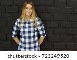 stunning blonde with slender... | Shutterstock . vector #723249520
