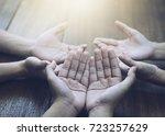 three people pray and praising... | Shutterstock . vector #723257629