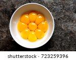 bright yellow egg yolks in a... | Shutterstock . vector #723259396