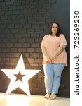 stunning fat girl with velvety... | Shutterstock . vector #723269230