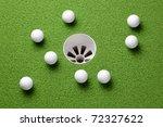 Several Golf Balls Near Hole O...