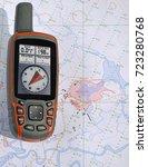 handheld gps navigator on a map ... | Shutterstock . vector #723280768