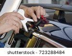 hands of car mechanic in the... | Shutterstock . vector #723288484