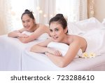 Small photo of Beautiful girl smiler on white bed in spa salon