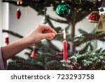 female hand lighting candle on... | Shutterstock . vector #723293758