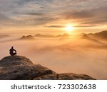 tourist sit on peak of... | Shutterstock . vector #723302638