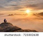 Tourist Sit On Peak Of...