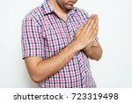 prayer. man. | Shutterstock . vector #723319498