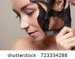 a black mask to the face of a... | Shutterstock . vector #723334288