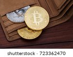 Metal bitcoins in brown leather ...