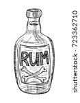 bottle of rum. black isolated... | Shutterstock .eps vector #723362710